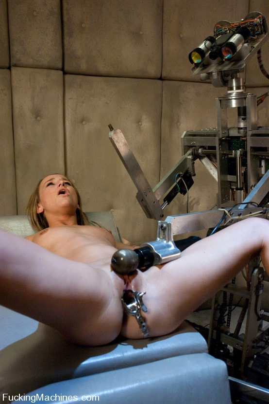 Tied up slut drilled by sex machines in the bdsm photo